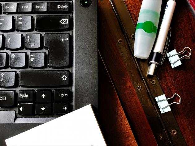 Laptop and other office equipment on old wooden desk | Credit: Tanya Thompson
